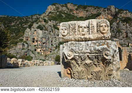 Ruins of ancient city of Myra in Demre, Turkey. Theatrical masks relief and ancient rock tombs in Lycia region