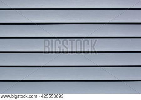 Blue Construction Vinyl Siding Panels. House Covered With Plastic Vinyl Siding. Vinyl Siding Wall Su