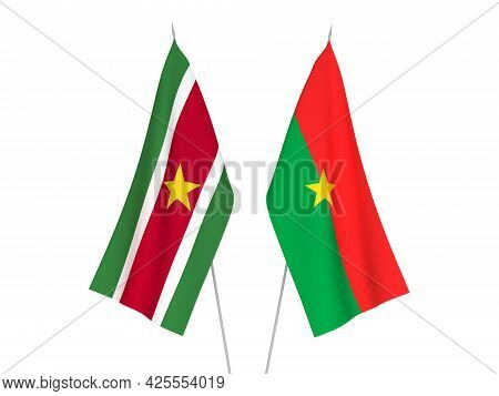National Fabric Flags Of Burkina Faso And Republic Of Suriname Isolated On White Background. 3d Rend