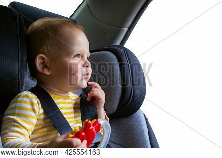 Adorable Caucasian Baby Boy Sitting In Grey Car Seat Inside The Car. Traveling By Car With Small Chi