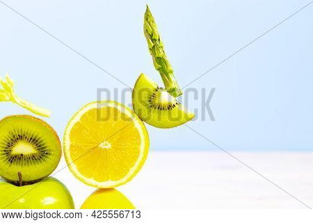 Fresh Vegetables And Fruits Such As Lemon, Kiwi, Asparagus And Celery. Equilibrium Floating Food. Ba