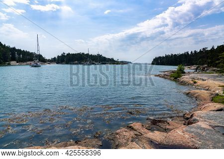 Sormland, Sweden - 22 June 2021: Sailboats Moored In The Lagoon Of The Archipelago At Stendorren Nat