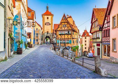 Rothenburg Ob Der Tauber, Bavaria, Germany. Beautiful Sunset Postcard View Of Ploenlein Square In Ro