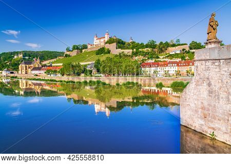 Wurzburg, Germany. Beautiful Water Reflection Of Marienberg And Old Bridge Over Main River. Travel S