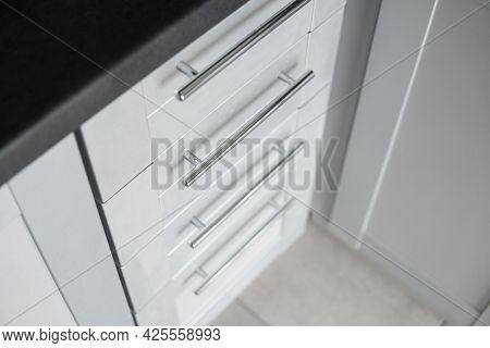 Modern Minimalist Style Kitchen Close Up In Monochrome Tones. Custom Kitchen With Grey White Facades