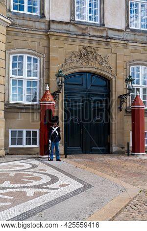 Copenhagen, Denmark - 13 June, 2021: Palace Guard On Watch Duty Outside The Amalienborg Palace In Do
