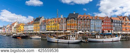 Copenhagen, Denmark - 13 June, 2021: Panorama View Of The Historic Nyhavn Quarter In Downtown Copenh
