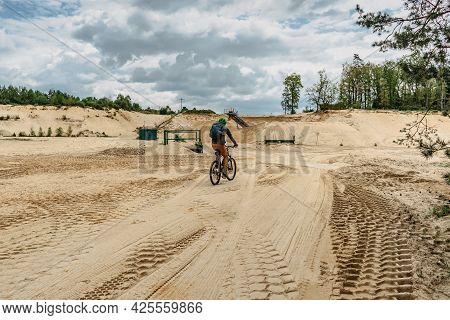 Cyclist Riding A Bicycle In Sandstone Quarry.sport, Recreation And Leisure Outdoors.active Bearded M