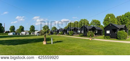 Hillerod, Denmark - 13 June, 2021: Panorama View Of An Idyllic Campground In Denmark With Little Bla