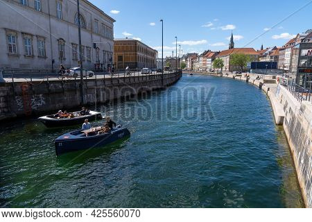Copenhagen, Denmark - 13 June, 2021: People Enjoy A Recreational Boat Cruise On The Canals Of Copenh
