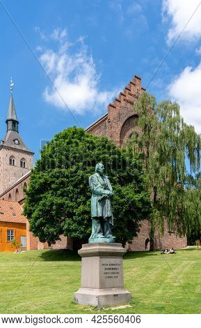 Odense,denmark - 9 June, 2021: Statue Of Hans Christian Andersen In The Park Of Saint Canute Cathedr