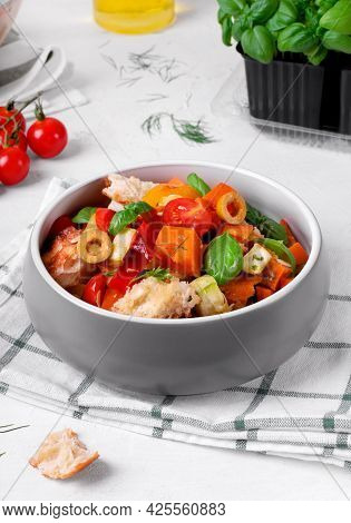 Salad With Baked Vegetables, Croutons, Olives, Capers, Cherry Tomatoes, Basil And Olive Oil Served I