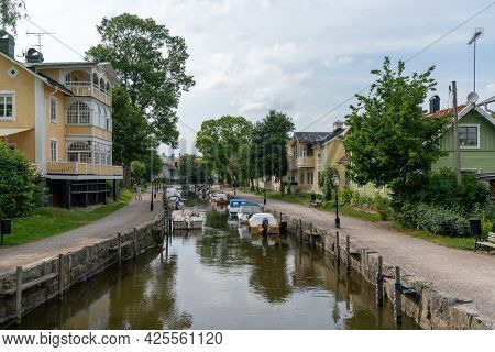 Trosa, Sweden - 22 June, 2021: Many Boats Line The Canals Of The Harbor Front In The Idyllic Swedish