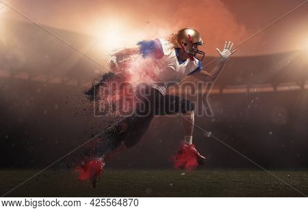 Young Man American Football Player At Stadium In Motion In Explosion Of Colored Neon Powder. Action,
