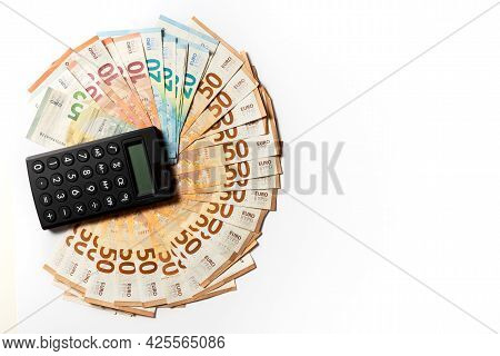 Money. Cash. Euro Bills And Calculator On The Table. The Salary. Poverty And Wealth Concept. Money S