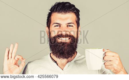 Good Morning, Man Tea, Ok. Smiling Hipster Man With Cup Of Fresh Coffee, Happy Man Showing Ok Sign.