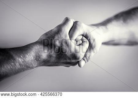 Friendly Handshake, Friends Greeting. Rescue, Helping Hand. Male Hand United In Handshake. Man Help