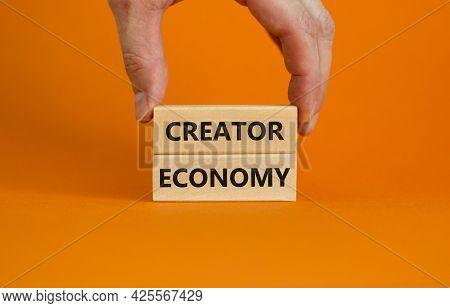 Creator Economy Symbol. Wooden Blocks With Words Creator Economy On Beautiful Orange Background, Cop