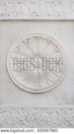 Beautifully hand carved flower shaped design motif on white marble. Intricate stone carving details from old temples in India.