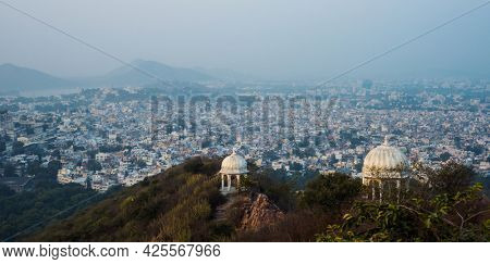 Spectacular panoramic view of a historic city- Udaipur. Heritage architecture from Mogul era against a sprawling city from Rajasthan, India.
