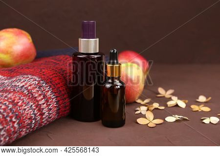 Unbranded Dark Brown Spray Bottle, Serum With Hyaluronic Acid In Brown Glass Bottle And Red Knitted