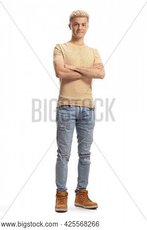 Full length portrait of a guy with bleached hair isolated on white background