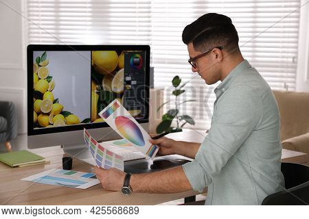 Professional Retoucher Working On Computer In Office