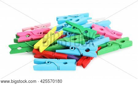 Pile Of Colorful Wooden Clothespins On White Background