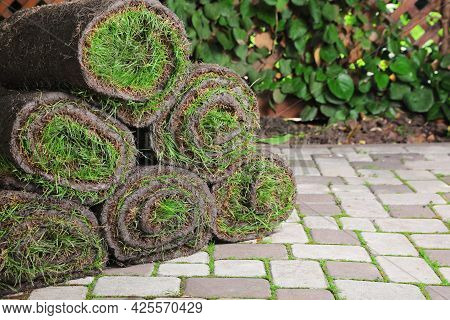 Rolls Of Sod With Grass On Backyard, Space For Text