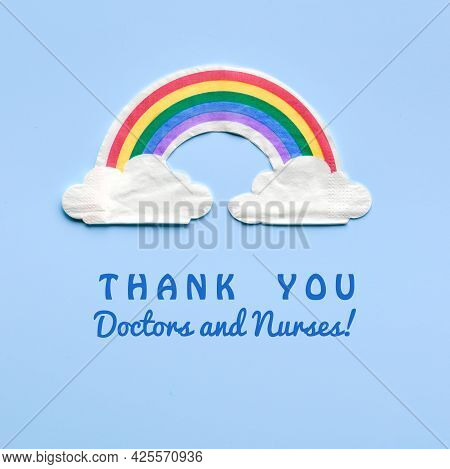 Rainbow With Clouds. Text Thank You Doctors And Nurses. Many Thanks To Nhs Fighting Pandemics. Motiv