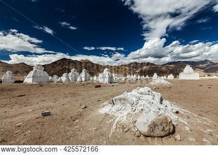 Whitewashed Buddhist chortens (Tibetan Buddhist stupas). Ladakh, Jammu and Kashmir, India