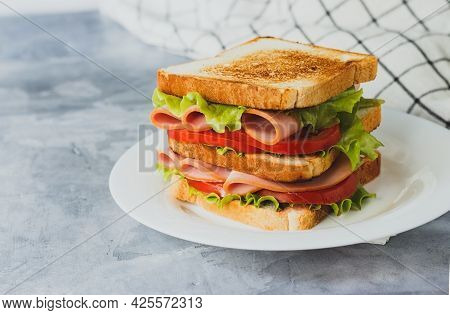 Smoked Turkey Sandwich With Ham, Tomatoes And Salad Lettuce