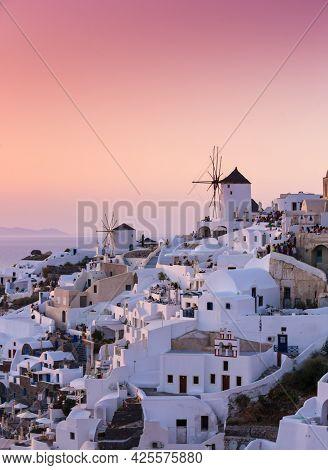 Beautiful sunset in famous romantic village Oia Santorini, Greece.