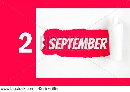 September 2nd. Day 2 Of Month, Calendar Date. Red Hole In The White Paper With Torn Sides With Calen