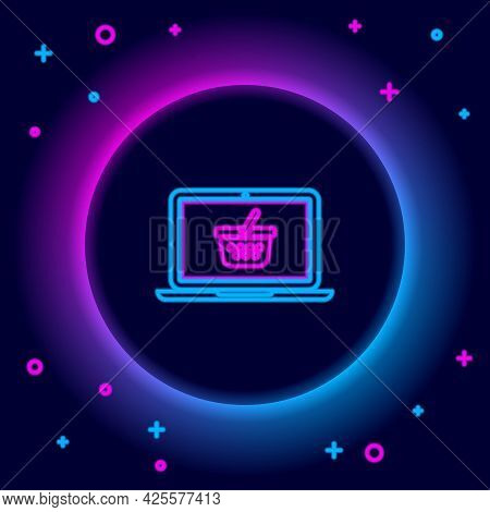 Glowing Neon Line Shopping Basket On Screen Laptop Icon Isolated On Black Background. Concept E-comm
