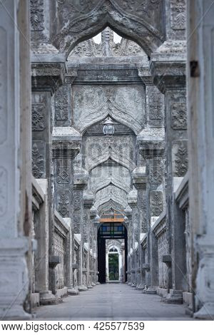 Empty Passage With Stone Arches Decorated With Traditional Asian Patterns At Bali Water Palace, Indo
