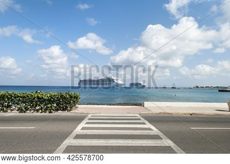The View Of A Crosswalk In George Town And Drifting Cruise Ships In A Background (grand Cayman, Caym