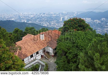 A Building On Top Of Penang Hill With The City Of Air Itam, Penang Malaysia In The Background.