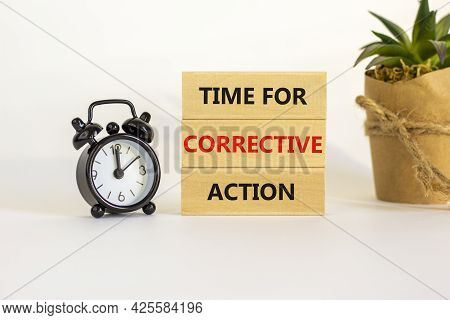 Time For Corrective Action Symbol. Blocks With Words Time For Corrective Action. Black Alarm Clock,