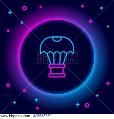 Glowing Neon Line Box Flying On Parachute Icon Isolated On Black Background. Parcel With Parachute F