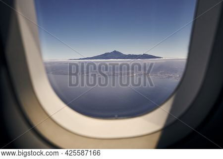 Aerial View From Airplane Window. Volcano Teide On Tenerife At Sunny Day. Canary Islands, Spain.