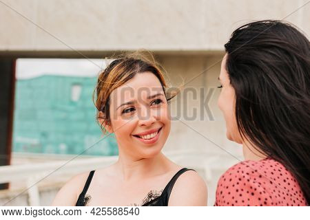 Two Female Friends Talking And Laughing Outdoors. Real Life And Friendship Concept.