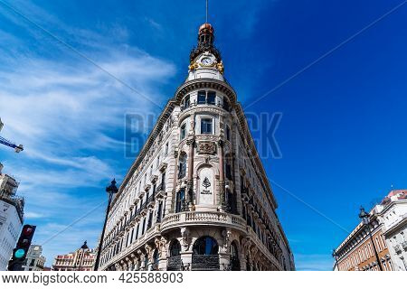 Madrid, Spain - May 8, 2021: The Four Seasons Hotel In Canalejas. Low Angle View Against Bright Blue