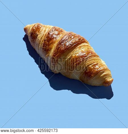 Bakery Products Baked Croissant  At Minimal Background. Delicious And Food Concept.