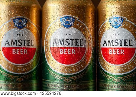 Beer Cans With Water Drops. Close-up Of Cans Of Amstel Beer Covered With Water Droplets. World Famou