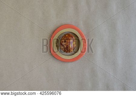 One Egg, Painted In Brown Colors, On Craft Paper Background. Minimalism Concept. Unusual Pattern On