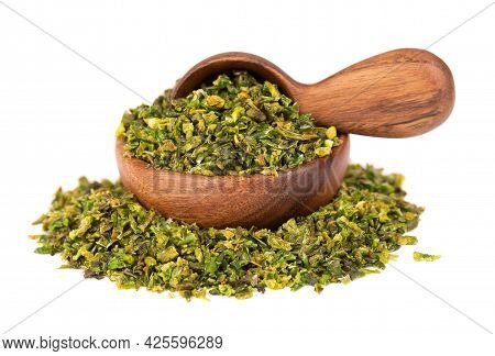 Dried Green Paprika Flakes With Seeds In Wooden Bowl And Spoon, Isolated On White Background. Choppe