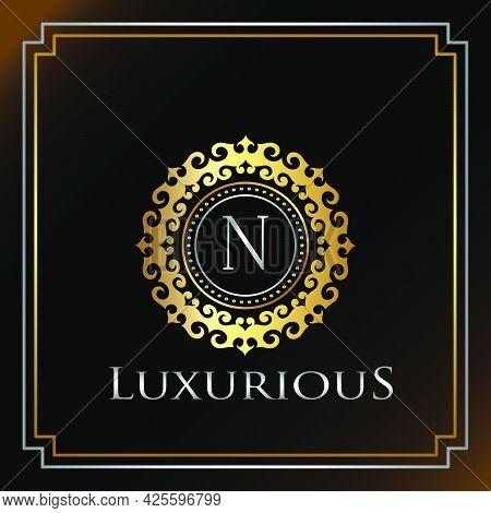 Gold Luxury Ornate Badge N Logo Letter. Elegance Ornate Decorative Luxury Initial Logo Template Gold
