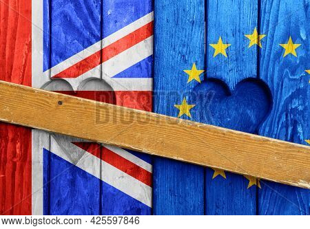 Close Up Closed Wooden Window Shutters With Heart Shapes, Uk And Eu Flags Painted As Symbol Of Brexi