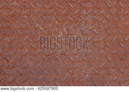 Background Texture Of Rusty Corroded Weathered Industrial Anti Slip Embossed Metal Steel Plate Surfa